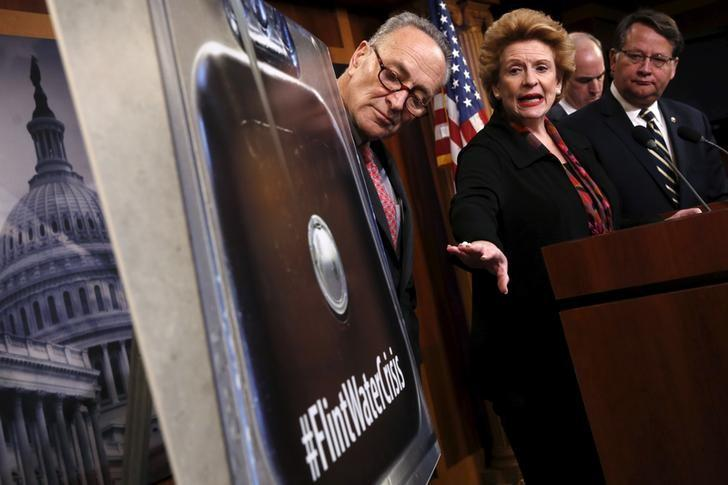 U.S. Senator Debbie Stabenow (D-MI) (3rd R) leads a news conference about potential legislation in response to the water crisis in Flint, Michigan, with Senator Chuck Schumer (D-NY) (L-R), Senator Bob Casey (D-PA) and Senator Gary Peters (D-MI), at the U.S. Capitol in Washington January 28, 2016. REUTERS/Jonathan Ernst