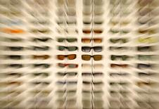 Some of the hundreds of sunglasses are seen on display at the annual ASR convention in San Diego in this September 9, 2005 file photo. REUTERS/Mike Blake/Files