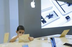 A boy views an iPad at an Apple shop in the Central Universal Department Store (TsUm) in Moscow, Russia, July 31, 2015. REUTERS/Maxim Shemetov