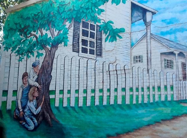 A hand-painted mural showing a scene of the 1960 bestseller '' To Kill A Mockingbird'' is shown on a building near where the homes of 1960's writers Harper Lee and Truman Capote's homes once stood in Monroeville, Alabama October 23, 2013.  REUTERS/Verna Gates