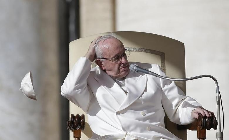 A gust of wind blows away Pope Francis' skullcap during his weekly general audience in Saint Peter's Square at the Vatican, February 10, 2016. REUTERS/Max Rossi