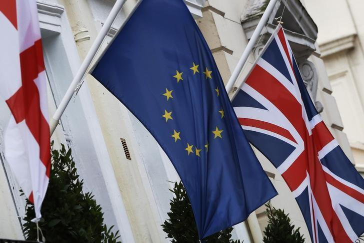 The St George's Cross, European Union and Union flags fly outside a hotel in London, Britain,  December 17, 2015. REUTERS/Luke MacGregor/Files