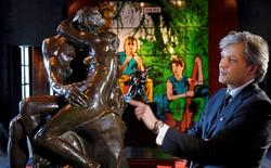 "Auctioneer Alexandre Giquello looks at the sculpture ""Le Baiser"" (the Kiss), bronze cast made in 1927, which is part of an exceptional sale of five remarkable bronzes by the French sculptor Auguste Rodin (1840-1917), displayed in Paris, France, February 11, 2016. REUTERS/Philippe Wojazer"