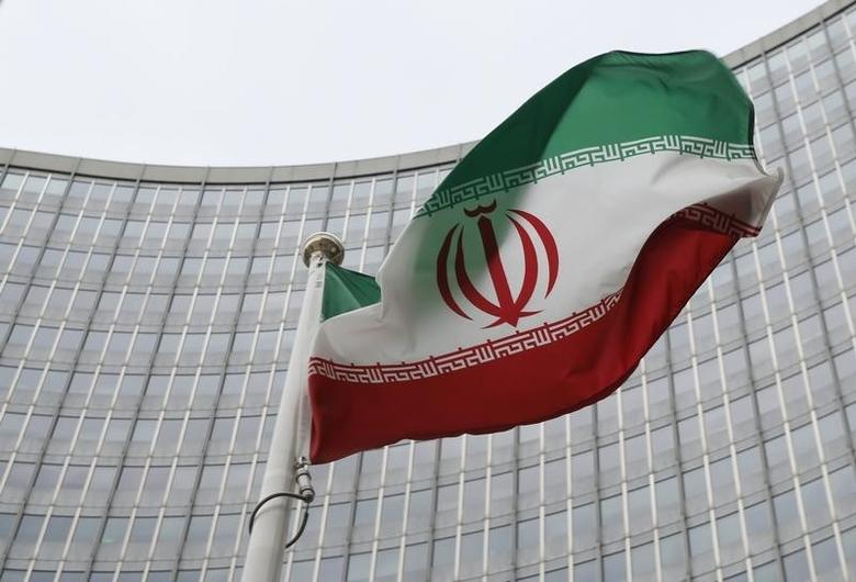 An Iranian flag flutters in front of the International Atomic Energy Agency (IAEA) headquarters in Vienna, Austria, January 15, 2016.   REUTERS/Leonhard Foeger
