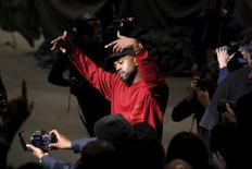 "Kanye West dances during his Yeezy Season 3 Collection presentation and listening party for the ""The Life of Pablo"" album during New York Fashion Week February 11, 2016. REUTERS/Andrew Kelly"