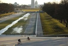 Cyclists pass each other by the frozen Lincoln Memorial Reflecting Pool (left) during the annual cleaning in Washington January 19, 2016. T REUTERS/Gary Cameron