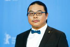 Director Yang Chao poses during a photocall to promote the movie 'Chang Jiang Tu' (Crosscurrent) at the 66th Berlinale International Film Festival in Berlin, Germany, February 15, 2016. REUTERS/Hannibal Hanschke