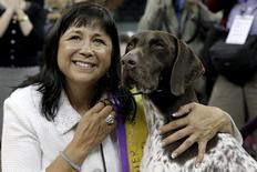 Handler Valerie Nunez Atkinson poses with CJ, a German Shorthaired Pointer from the Sporting Group, after they won Best in Show at the Westminster Kennel Club Dog show at Madison Square Garden in New York February 16, 2016. REUTERS/Brendan McDermid