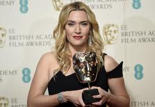 Actress Kate Winslet poses with her award for best supporting actress at the British Academy of Film and Television Arts (BAFTA) Awards at the Royal Opera House in London, February 14, 2016. REUTERS/Toby Melville