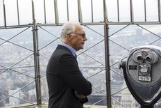 Soccer legend Franz Beckenbauer pauses to look out on the city on top of the Empire State Building during an event to celebrate the start of the New York Cosmos 2015 season, in New York April 17, 2015. REUTERS/Lucas Jackson - RTR4XSOR
