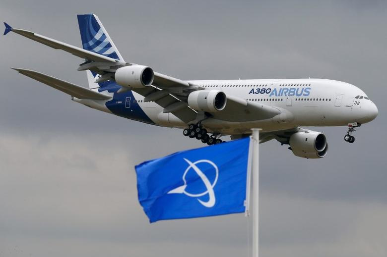 An Airbus A380, the world's largest jetliner, flies over a Boeing flag while landing after a flying display during the 51st Paris Air Show at Le Bourget airport near Paris, June 18, 2015. REUTERS/Pascal Rossignol