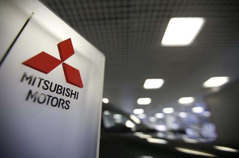 The logo of Mitsubishi Motors is seen on a board at a showroom of the Avtomir company, a Mitsubishi cars dealership, in Moscow, April 1, 2015. REUTERS/Maxim Zmeyev
