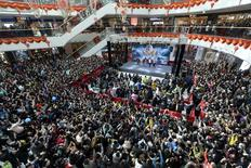 People attend a promotional event with Hong Kong star Stephen Chow for the film, The Mermaid, in Taiyuan, Shanxi Province, China, February 17, 2016. REUTERS/China Daily