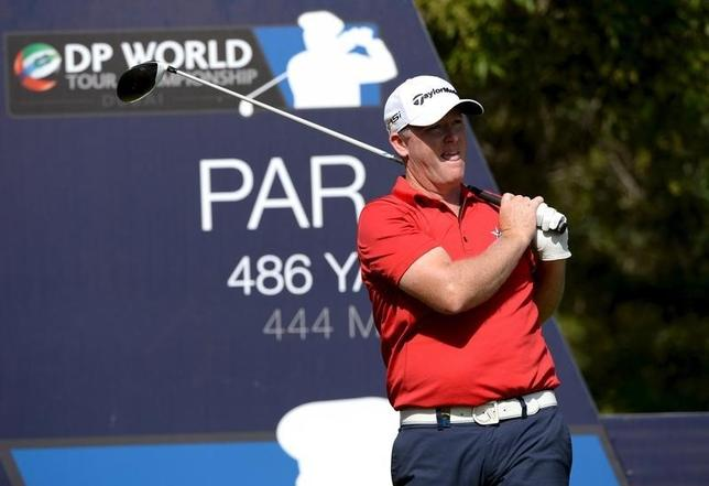 Marcus Fraser of Australia looks at the ball after the tee off at the hole number 16 during DP World Tour Championship in Dubai, in this file photo dated November 19, 2015. REUTERS/Martin Dokoupil