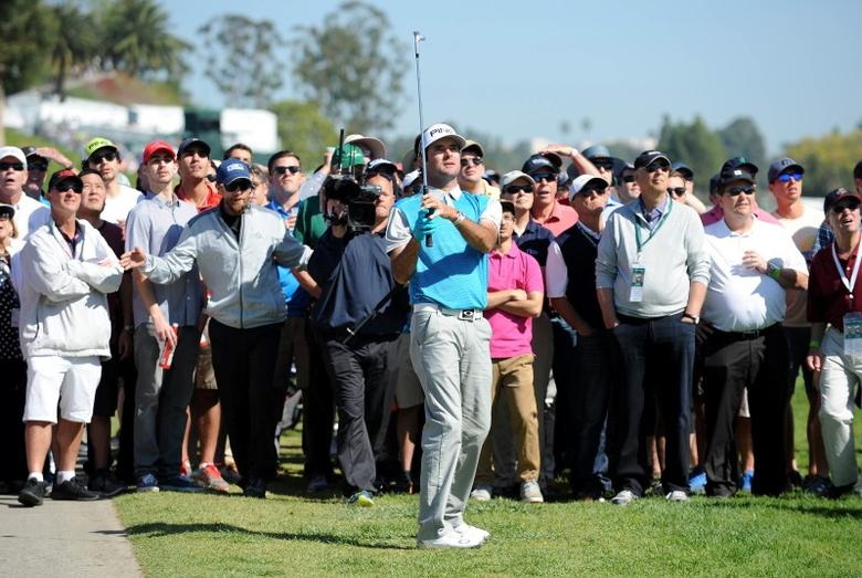 February 21, 2016; Pacific Palisades, CA, USA; Bubba Watson hits from the rough on the third hole course during the final round of the Northern Trust Open golf tournament at Riviera Country Club. Mandatory Credit: Gary A. Vasquez-USA TODAY Sports