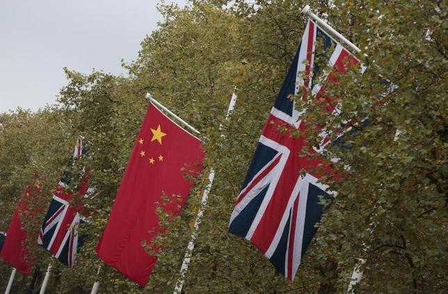 Chinese and British flags fly along the Mall in London, Britain in this October 19, 2015 file photo. REUTERS/Suzanne Plunkett