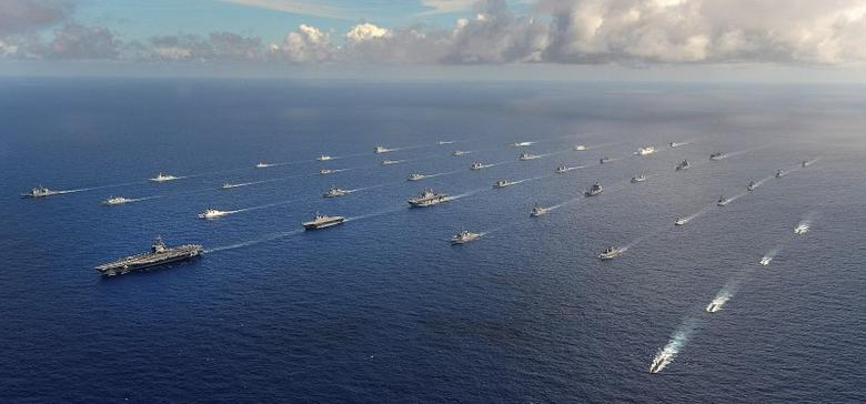 More than 40 ships and submarines representing 15 international partner nations travel in formation in the Pacific Ocean during the Rim of the Pacific (RIMPAC) 2014 exercise in this U.S. Navy photo taken July 25, 2014, and released July 31, 2014.  REUTERS/U.S. Navy/Mass Communication Specialist 1st Class Shannon E. Renfroe/Handout
