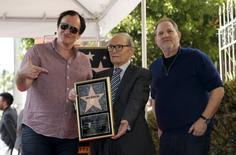 Italian composer Ennio Morricone (C) poses on his star with director Quentin Tarantino (L) and producer Harvey Weinstein after it was unveiled on the Hollywood Walk of Fame in Hollywood, California February 26, 2016.   REUTERS/Mario Anzuoni