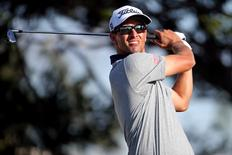 Feb 27, 2016; Palm Beach Gardens, FL, USA; Adam Scott tees off on the 14th hole during the third round of the Honda Classic. at PGA National (Champion). Mandatory Credit: Peter Casey-USA TODAY Sports