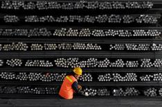 A labourer marks steel bars at a steel and iron factory in Huai'an, Jiangsu province, China, in this February 18, 2008 file photo. REUTERS/Patty Chen/Files