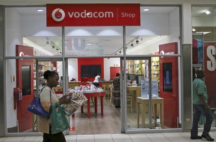 A shopper walks past a Vodacom shop in Johannesburg February 4, 2015.  REUTERS/Siphiwe Sibeko