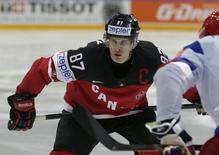 Canada's Sidney Crosby gets ready for a face off during their Ice Hockey World Championship final game at the O2 arena in Prague, Czech Republic May 17, 2015. REUTERS/David W Cerny