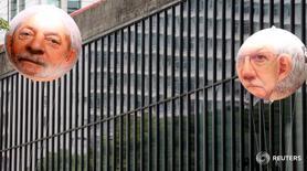 Шарики с портретом экс-президента Бразилии Луиса Инасиу Лулу да Силву в Сан-Паулу 13 декабря 2015 года. Федеральная полиция Бразилии задержала в пятницу бывшего лидера страны Луиса Инасиу Лулу да Силву для допроса в рамках дела о коррупции и отмывании денег. REUTERS/Paulo Whitaker