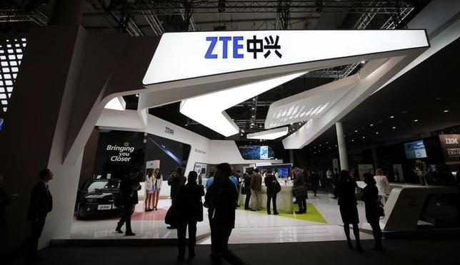 Visitors check out products at the ZTE stand at the Mobile World Congress in Barcelona, February 24, 2014.  REUTERS/Albert Gea