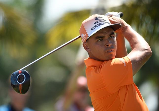 Mar 6, 2016; Miami, FL, USA; Rickie Fowler follows his drive off the second tee during the final round at TPC Blue Monster at Trump National Doral.  John David Mercer-USA TODAY Sports