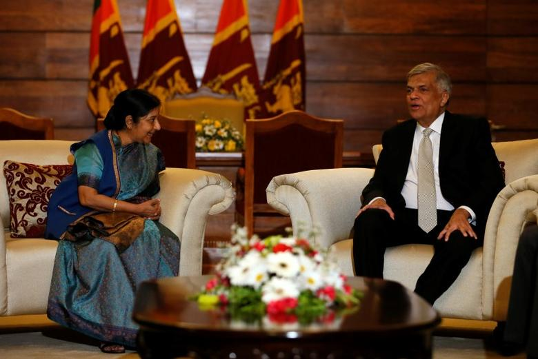 India's External Affairs Minister Sushma Swaraj (L) talks to with Sri Lanka's Prime Minister Ranil Wickremesinghe during their meeting in Colombo, Sri Lanka February 5, 2016. REUTERS/Dinuka Liyanawatte - RTX25KW1