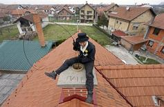 Dajana Djuric, 25, who has worked as a chimney sweep since the age of six, cleans a chimney in Brcko, Bosnia and Herzegovina. Picture taken March 3, 2016. REUTERS/Dado Ruvic