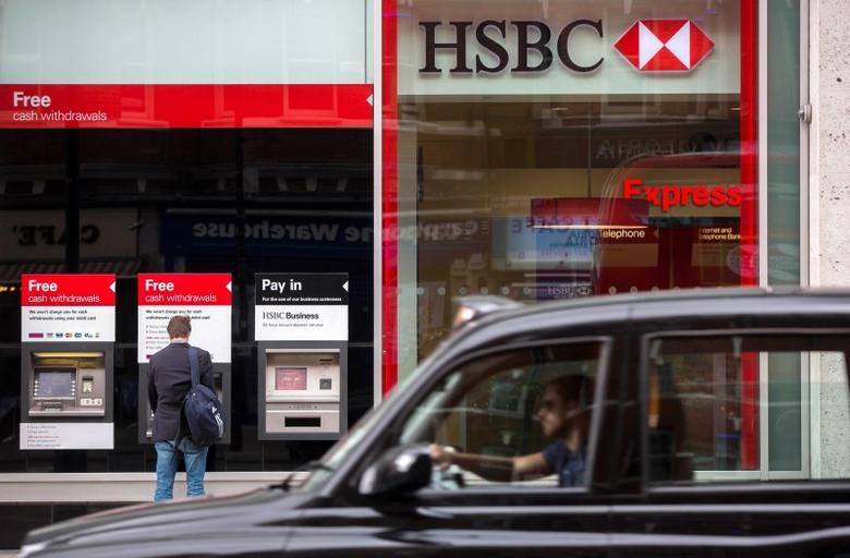 A taxi drives past a branch of the HSBC bank in central London, Britain June 09, 2015.  REUTERS/Neil Hall
