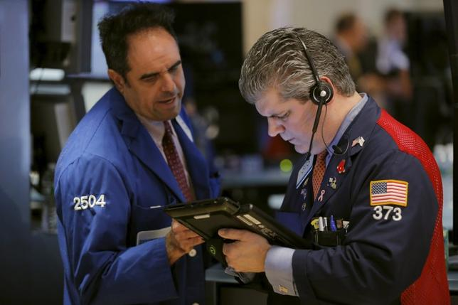 Traders work on the floor of the New York Stock Exchange shortly after the opening bell in New York, March 14, 2016. REUTERS/Lucas Jackson