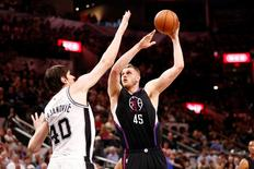 Los Angeles Clippers center Cole Aldrich (45) shoots the ball over San Antonio Spurs center Boban Marjanovic (40) during the second half at AT&T Center. Mandatory Credit: Soobum Im-USA TODAY Sports