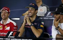 Ferrari F1 driver Sebastian Vettel (L) sits alongside Red Bull Racing F1 driver Daniel Ricciardo and Mercedes F1 driver Lewis Hamilton during a news conference at the Australian Formula One Grand Prix in Melbourne. REUTERS/Brandon Malone