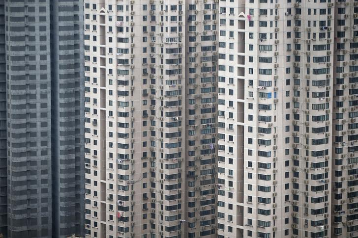 Buildings of a residential compound are seen in Shanghai, China, March 17, 2016. REUTERS/Aly Song