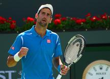 Mar 19, 2016; Indian Wells, CA, USA; Novak Djokovic (SRB) pumps his fist after defeating Rafael Nadal (ESP) in his semifinal match in the BNP Paribas Open at the Indian Wells Tennis Garden. Djokovic won 7-6, 6-3. Mandatory Credit: Jayne Kamin-Oncea-USA TODAY Sports