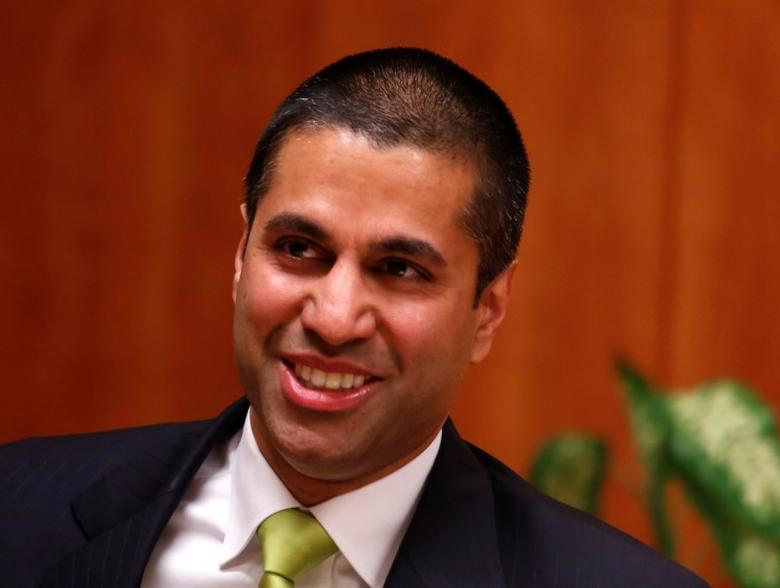 Federal Communications Commission (FCC) commissioner Ajit Pai arrives at a FCC Net Neutrality hearing in Washington February 26, 2015. REUTERS/Yuri Gripas