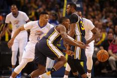 Mar 24, 2016; Oklahoma City, OK, USA; Utah Jazz guard Shelvin Mack (8) drives to the basket against Oklahoma City Thunder guard Russell Westbrook (0) during the second quarter at Chesapeake Energy Arena. Mandatory Credit: Mark D. Smith-USA TODAY Sports