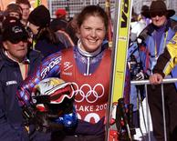 Picabo Street of the U.S. smiles in the finish area of the Olympic women's downhill course at Snowbasin, in this file photo taken February 9, 2002. REUTERS/Leonhard Foeger/Files