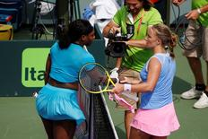 Svetlana Kuznetsova (R) shakes hands with Serena Williams (L) after their match on day seven of the Miami Open at Crandon Park Tennis Center. Kuznetsova won 6-7(3), 6-1, 6-2. Mandatory Credit: Geoff Burke-USA TODAY Sports