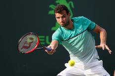 Mar 28, 2016; Key Biscayne, FL, USA; Grigor Dimitrov hits a forehand against Andy Murray (not pictured) during day seven of the Miami Open at Crandon Park Tennis Center. Geoff Burke-USA TODAY Sports