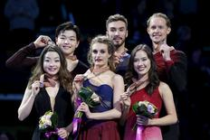 Figure Skating - ISU World Figure Skating Championships - Ice Dance Free Dance - Boston, Massachusetts, United States - 31/03/16 - Silver medalists Maia Shibutani (L) and Alex Shibutani (2nd L) of the United States, gold medalists Gabriella Papadakis (3rd L) and Guillaume Cizeron (3rd R) of France, and bronze medalists Madison Chock (2nd L) and Evan Bates (R) of the United States pose on the medals podium. REUTERS/Brian Snyder