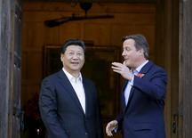 File photograph shows Britain's Prime Minister David Cameron (R) welcoming Chinese President Xi Jinping to his official residence at Chequers, Britain, October 22, 2015. REUTERS/Kirsty Wigglesworth/Pool/Files