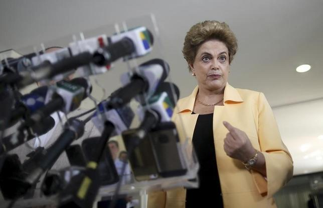 President Dilma Rousseff addresses a news conference after visiting the new Embraer KC 390 military transport aircraft in Brasilia, Brazil April 5, 2016. REUTERS/Adriano Machado