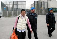 Giuseppe Salvatore Riina (L), the son of the most feared Sicilian Mafia boss, leaves a prison in Sulmona, central Italy, in a February 28, 2008 file photo.  REUTERS/Claudio Lattanzio/Files