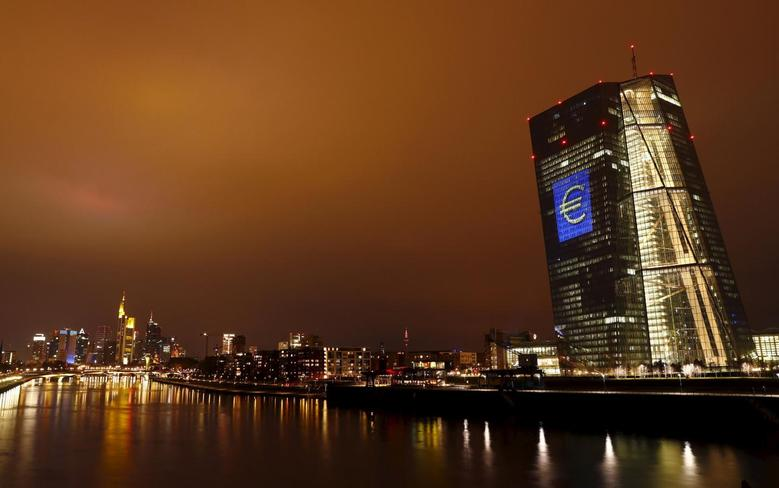 The head quarter of the European Central Bank (ECB) is illuminated with a giant euro sign at the start of the ''Luminale, light and building'' event in Frankfurt, Germany, March 12, 2016. REUTERS/Kai Pfaffenbach