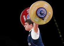 Nov 24, 2015; Houston, TX, USA; Andranik Karapetyan from Armenia competes in the men's 77kg group A competition during the International Weightlifting Federation World Championships at George R. Brown Convention Center. Mandatory Credit: Thomas B. Shea-USA TODAY Sports