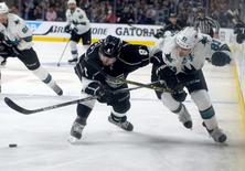 Apr 14, 2016; Los Angeles, CA, USA;  Los Angeles Kings defenseman Drew Doughty (8) and San Jose Sharks left wing Matt Nieto (83) chase down the puck in the third period of the game one of the first round of the 2016 Stanley Cup Playoffs at Staples Center. Sharks won 4-3. Jayne Kamin-Oncea-USA TODAY Sports