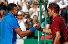 Tennis - Monte Carlo Masters - Monaco, 15/04/2016. Jo-Wilfried Tsonga of France (L) shakes hand with Roger Federer of Switzerland following their match.  REUTERS/Eric Gaillard
